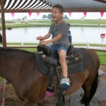 He had so much fun riding this pony