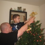 Daddy and Jace putting the Angel on the top of the tree